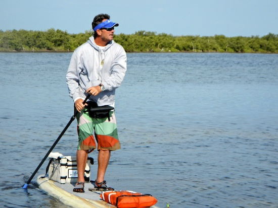 Tim looking for fish from his paddleboard.