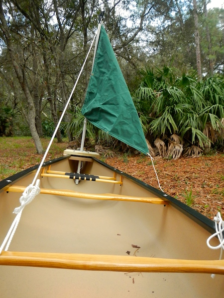 rigging a temporary sail for a canoe