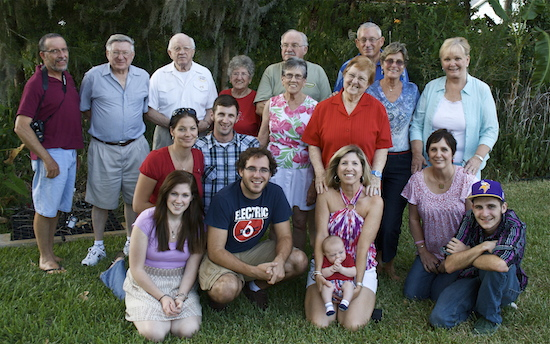 A family photo taken a couple years back. Mom is in the center of the back row.